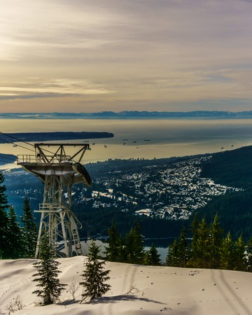 Grouse Mountain North Vancouver view from top to the cabel car tower city and the Bay Stock Photo