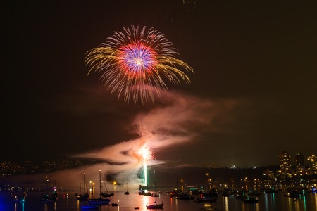 gunfire: colorful bright firework at night at summer time Stock Photo