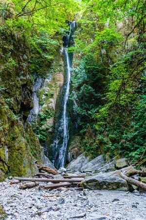 Summer time Niagara falls in Goldstream Provincial Park Vancouver Island British Columbia Canada