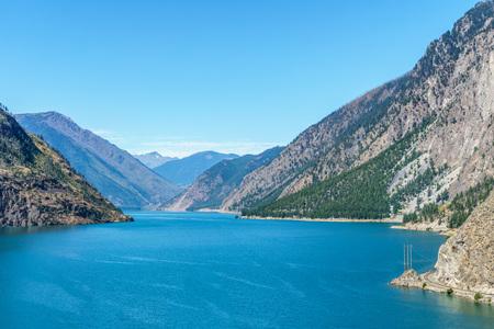 Seton lake near Lillooet British Columbia Canada high mountains with blue sky