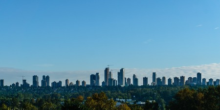 BURNABY, BC, CANADA - SEPTEMBER 23, 2017: High-rise buildings in the city of Burnaby against the blue sky