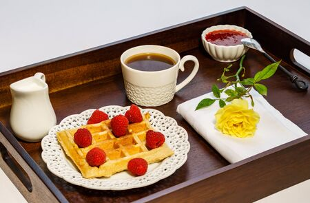 Fresh belgian waffle with berries with coffee breakfast on a tray. Stockfoto