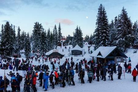 North Vancouver Canada - December 30, 2017: Grouse Mountain lots of people in the lain to Gondola Ride at the evening.