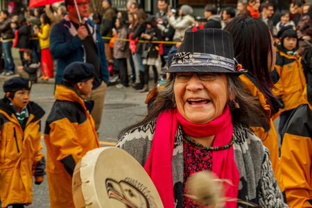 VANCOUVER, CANADA - February 2, 2014: First nations women marching at Chinese New Year parade in Vancouver Chinatown