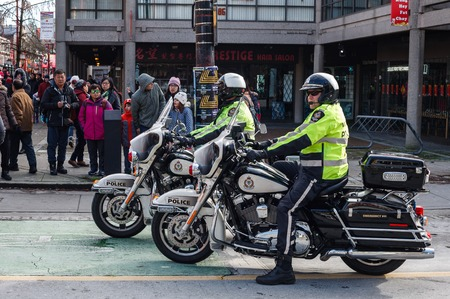VANCOUVER, CANADA - February 18, 2018: Vancouver Police Department Motocycle officers at Chinese New Year parade Editorial
