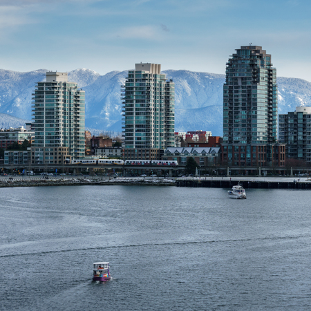 Vancouver Canada - February 18, 2018: Modern architecture and appartment buildings in Vancouver Canada near False Creek Editorial