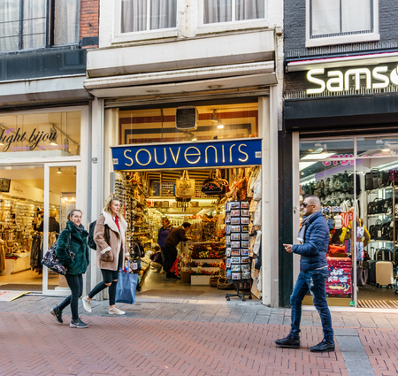 AMSTERDAM, NETHERLANDS - March 20, 2018 : Souvenir store on the street of Amsterdam