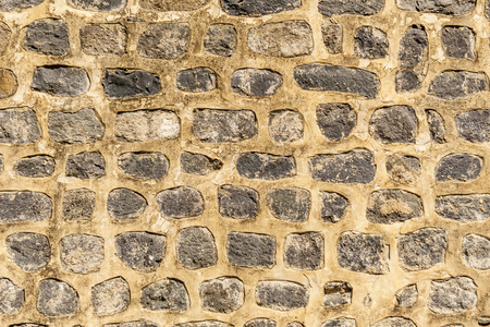 Ancient yellow brick wall background or texture Stock Photo