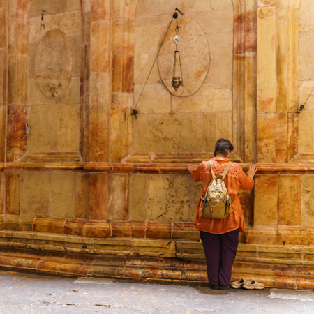 JERUSALEM, ISRAEL - April 2, 2018: woman is praying in the Church of the Holy Sepulchre