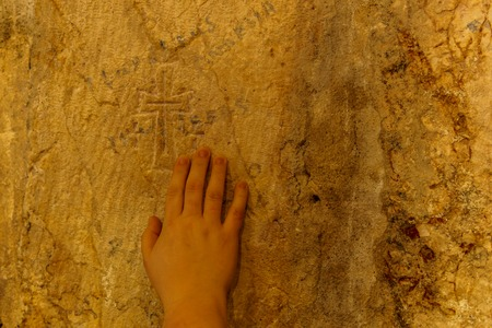 JERUSALEM, ISRAEL - April 2, 2018: hand on the wall inside the Church of the Holy Sepulchre