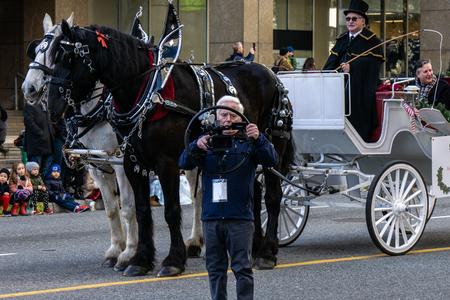 VANCOUVER, CANADA - DECEMBER 2, 2018: camera operator filming annual The Santa Claus Parade in Vancouver, Canada.