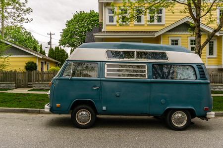 VANCOUVER, CANADA - May 4, 2018: modern home and old stile Volkswagen camper