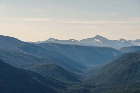 green mountain ridge scene with blue sky summer landscape background Foto de archivo - 116695511