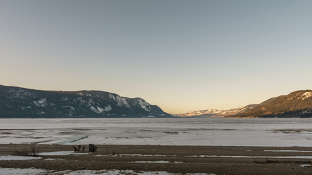 Cold morning landscape of frozen Little Shuswap Lake British Columbia Canada