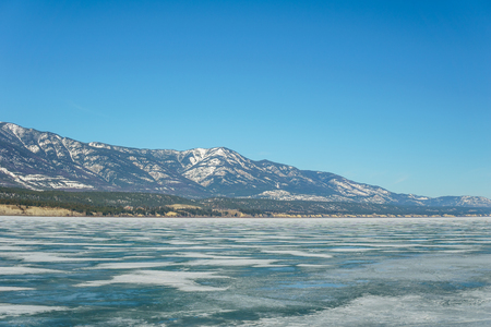 early spring landscape of frozen Columbia Lake Regional District of East Kootenay Canada Stock Photo