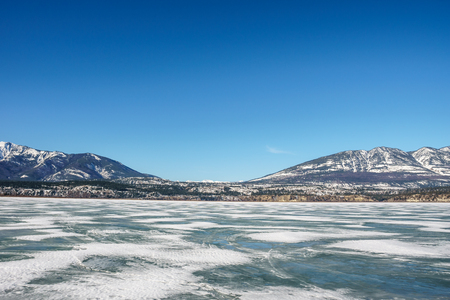 early spring landscape of frozen Columbia Lake Regional District of East Kootenay Canada 免版税图像