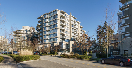 BURNABY, CANADA - NOVEMBER 17, 2019: apartment buildings and street view on sunny autumn day in British Columbia