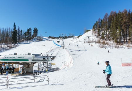 KIMBERLEY, CANADA - MARCH 19, 2019: ski track at alpine resort at sunny spring day