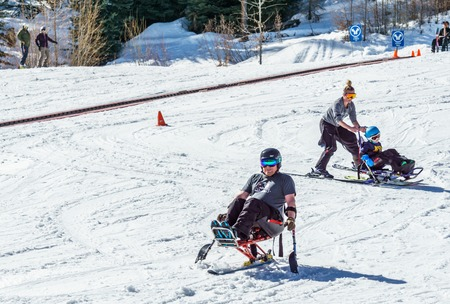 KIMBERLEY, CANADA - MARCH 19, 2019: handicapped person riding a mono ski Vancouver Adaptive Snow Sports