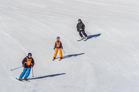KIMBERLEY, CANADA - MARCH 22, 2019: Mountain Resort view early spring people skiing Redactioneel