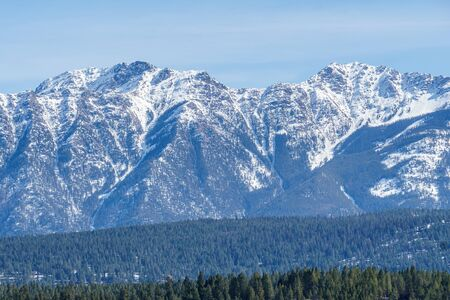 Canadian Rockies with snow in British Columbia Canada early spring clear sky Imagens