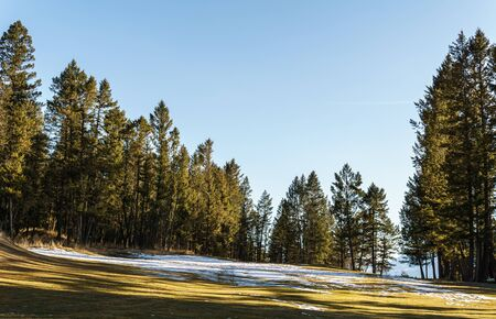 Golf Course field in small town in rocky mountains sunny afternoon