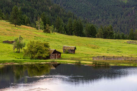 Large pond in swampy meadow among rolling hills country side british columbia Canada