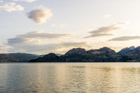 calm early morning at okanagan lake summer time british columbia canada.