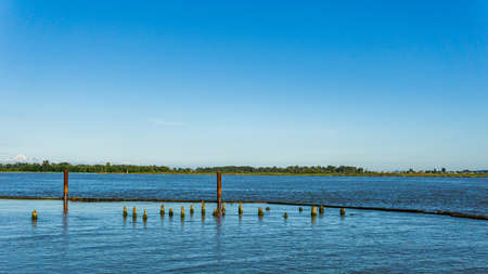 afternoon time at the Fraser River seen from shore at in Richmond British Columbia Canada