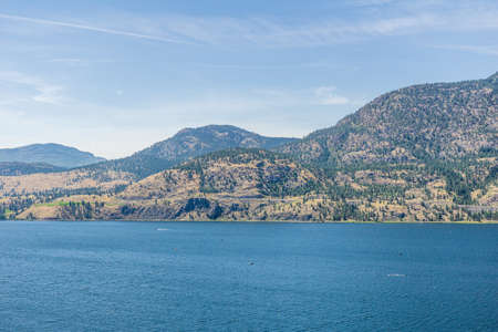 Skaha lake view at summer time with blue sky british columbia canada