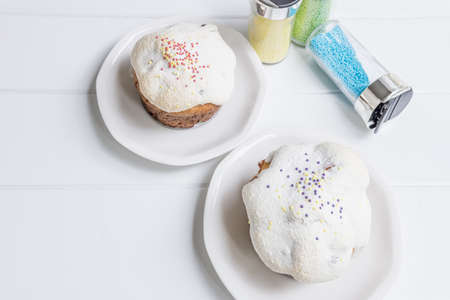 traditional ukrainian Easter cake kulich with glaze on a white wooden background Russian pastry.