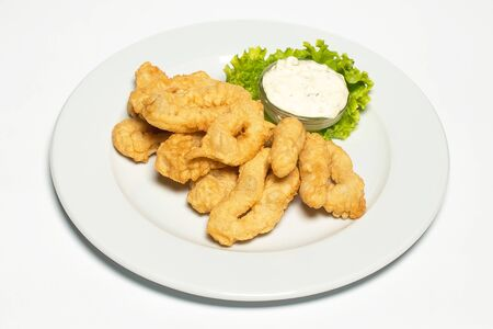 squid rings in a batter on a white background