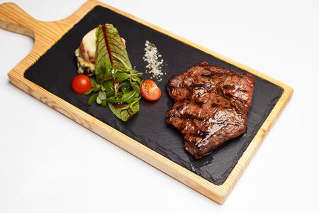 beef rib with a salad on a wood Stock fotó