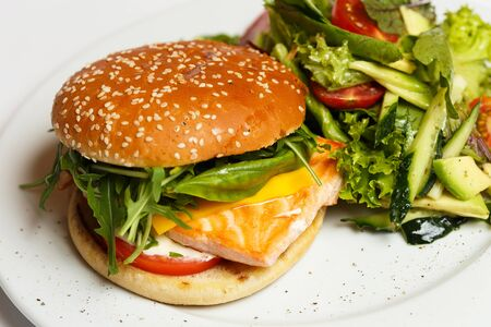 burger with a salmon and vegetables