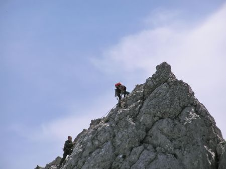 Two mountain-climbers on the top of rock alpinists Stock Photo - 687419