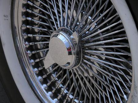 spoke: Old car silver spoke wheel fragment with number