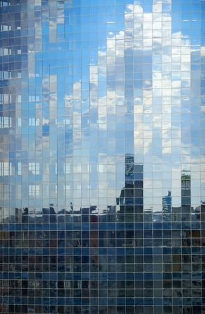 fragmented: Glass wall of modern beautiful building in Kiev. Fragmented reflection. Stock Photo