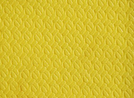 polyurethane: Polyurethane rug yellow color background