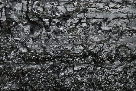 Black reflective coal backgroung