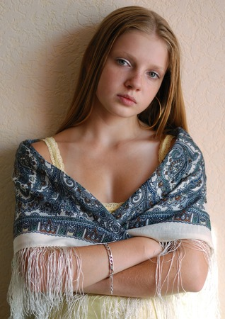 threw: Portrait of young long-haired model threw a shawl over