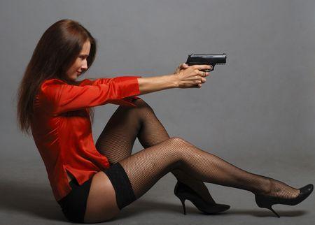 Women in red with big black gun