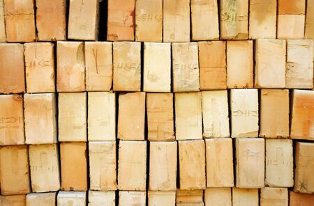slits: Vertical pile of yellow bricks with slits