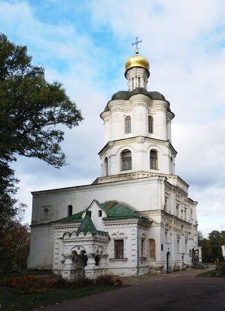 collegium: Collegium building with church in Chernigiv. Ukraine. Sky with clouds.