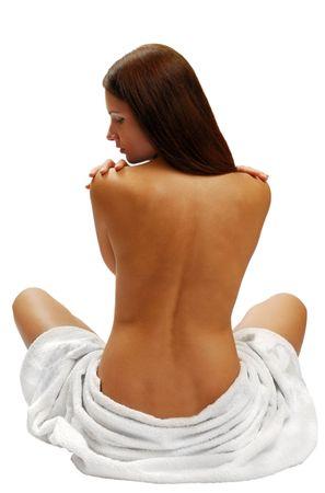 白いタオルを背面ビューからの美しい少女モデル