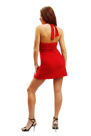 Woman in red short dress standing back, isolated on white background Stock Photo - 2435332