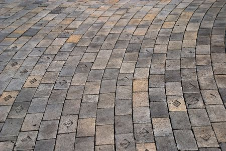 scabrous: Bent cobble pavement rows, scabrous pale surface and black edges of every blocks