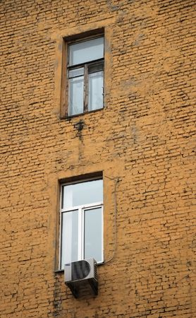double glass: Pair of hoary window and new double glass in old red brick wall, simple pattern Stock Photo