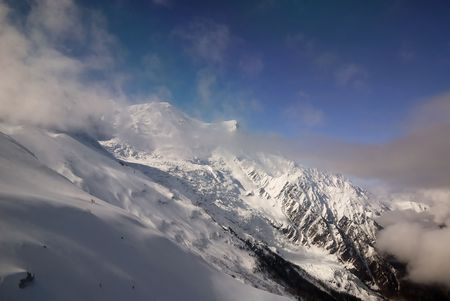 Snow white mountain peaks in clouds and blue sky, the Alps, Mont Blanc; Chamonix; France Stock Photo - 3049656