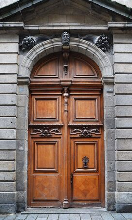unyielding: Old-fashioned massive wooden door decorated with encrustation, St. Malo, France Stock Photo