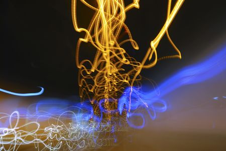 Abstract picture of yellow and blue light blurs in tunnel, dark background Stock Photo - 3141963